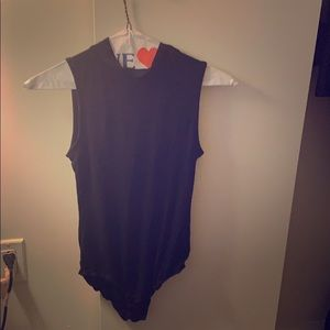 Black body suit with mock neck. Never worn! Size S